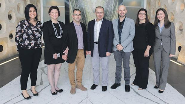 Members of the Deaf People Association Malta with Joseph Tabone and other members of management.
