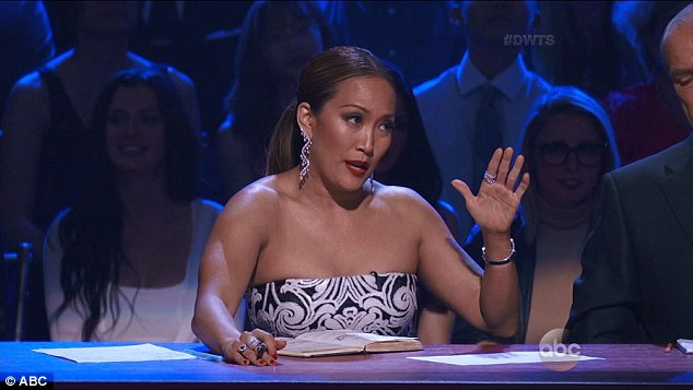 Tear-jerker: As the performance ended, his pro partner Peta Murgatroyd failed to hold back her tears, as did judge Carrie Ann Inaba (pictured)