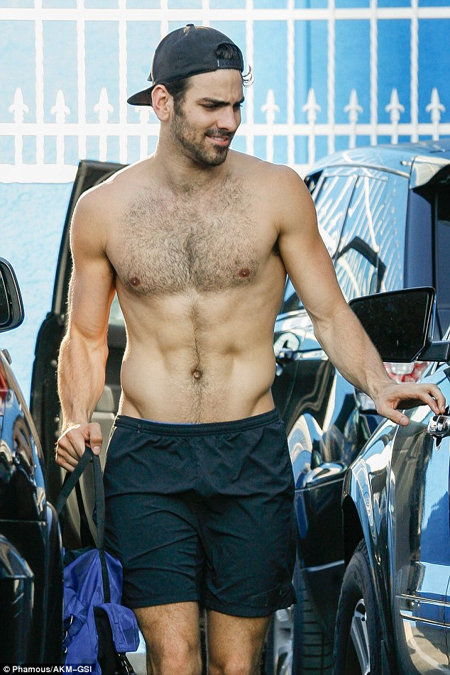 Eye candy:27-year-old heartthrob Nyle DiMarco flashed his six-pack abs along with a satisfied grin as he walked out and got into a car