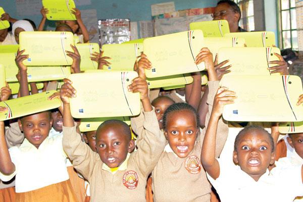 Excitement, challenges hit schools pilot laptop project