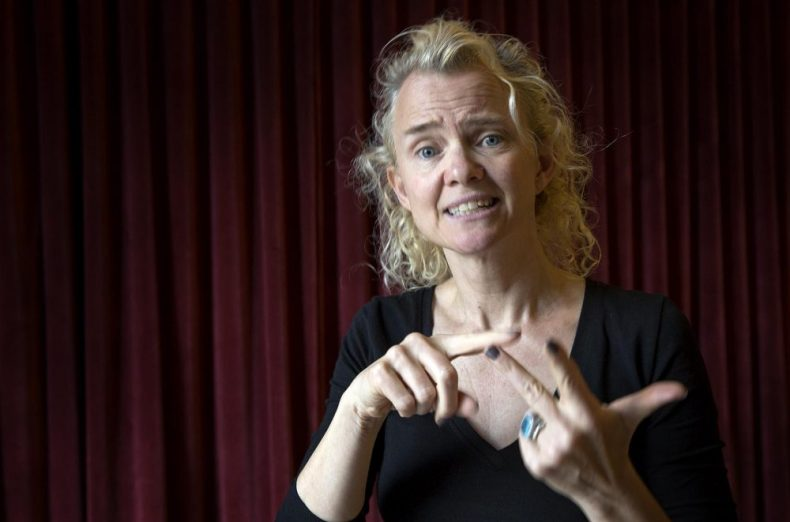 Sabrina Dennison said she's been working with Lucas since 2013 to translate his play into ASL. (Robin Lubbock/WBUR)