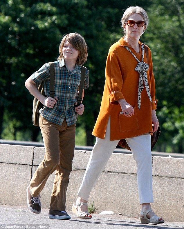 Moving the clock forward: Julianne Moore showed off a more mature look as she was spotted with costar Oakes Fegley on the set of upcoming drama Wonderstruck in Queens on Wednesday
