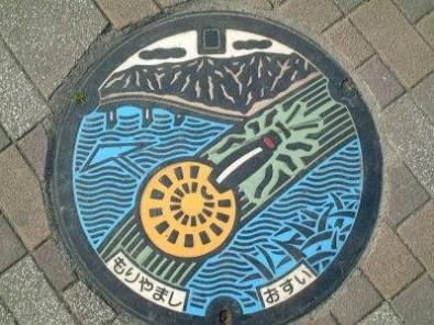 Moriyama has firefly art on its sewer covers