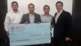 FreshCane accepting the grand prize at the 2016 JEDCO Challenge. Photo by JEDCO.