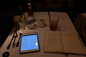My table at Dan Ryan's in Hong Kong. The Economist on my iPad, my Moleskine, and an iced tea.