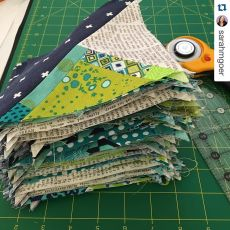 @sarahmgoer working on some scrappy triangles today! 🆒 ・・・%0AStarted at #QuiltCon with @jenib320. 92144 blocks now complete. Check back in my feed for how I'll set them. Switching gears now since I've used up all my scrappy units. #svmqgretreat #creati