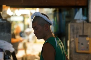 Tokyo Tsukiji Fish Market - worker wearing a moku, a towel with many uses