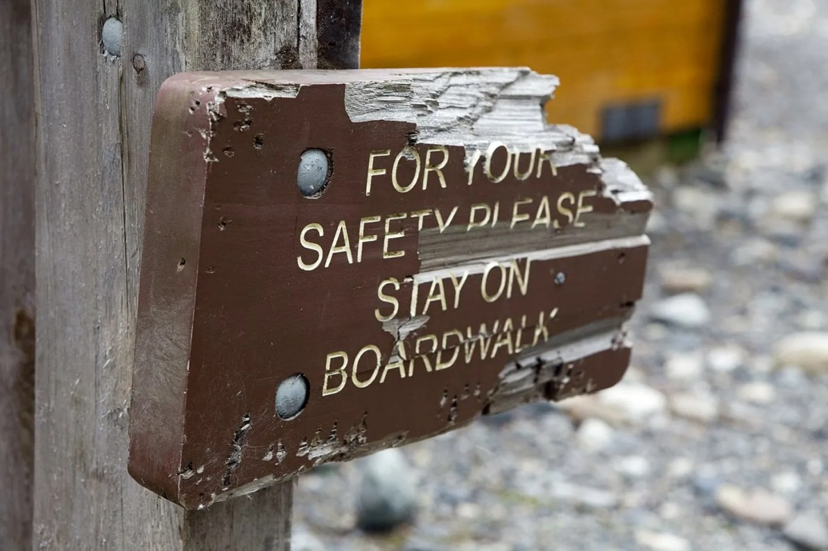 For your safety stay on boardwalk sign at the Fish Creek Wildlife Observation Site at the Tongass National Forest in Hyder, Alaska.