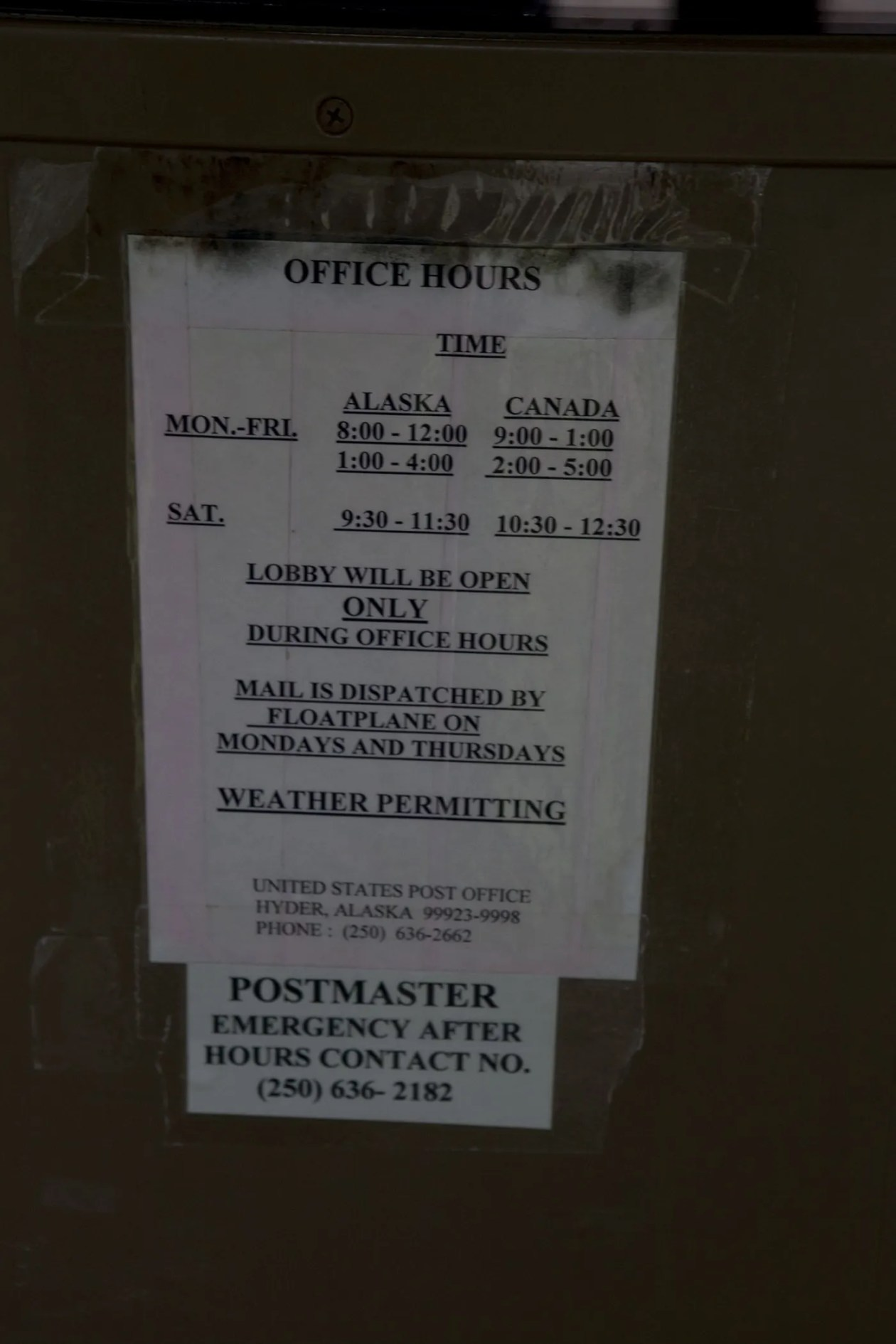 Mail is dispatched by floatplane sign at the Hyder, Alaska Post Office.