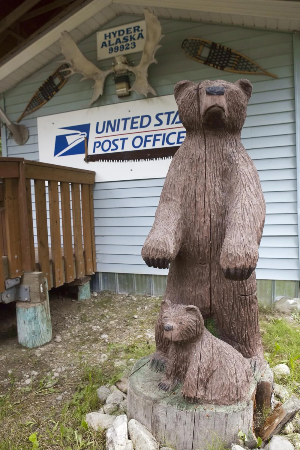Wooden carved bear and cub at the Hyder, Alaska Post Office.