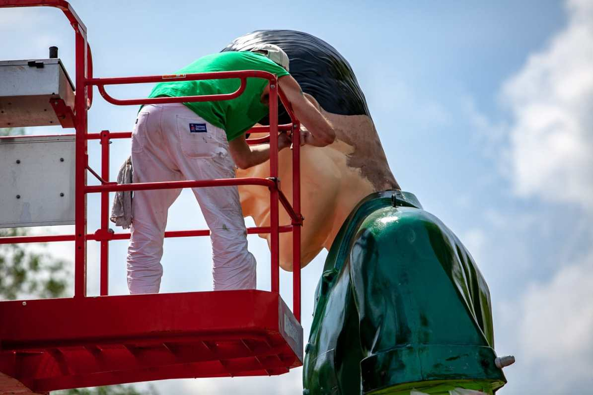 Painting the Gemini Giant Muffler man at the Launching Pad Drive In in Wilmington, Illinois on Route 66.