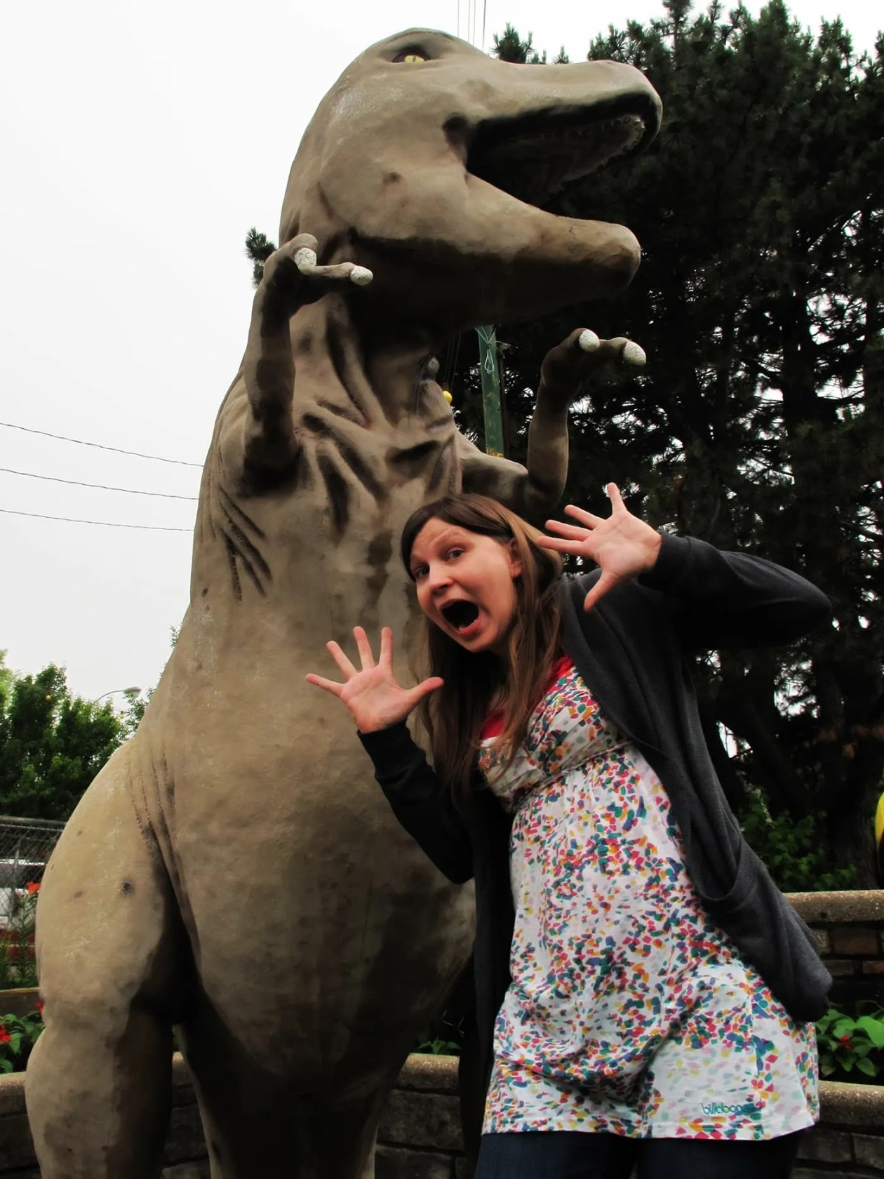 Val is scared of the dinosaur at Novelty Golf in Lincolnwood, Illinois.