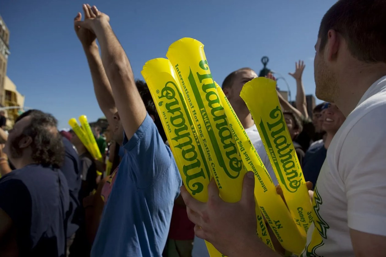 Fans hold thunder sticks at the Nathan's Famous hot dog eating contest at Coney Island.