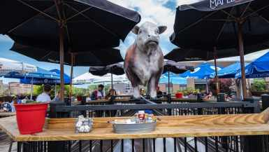 Gene's Sausage Shop rooftop cow. Giant cow statue in Lincoln Square, Chicago, Illinois.