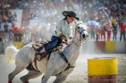Vaquera compite en la carrera entre barriles en el Torneo Internacional de Rodeo y Coleo, durante la Feria Internacional Agroindustrial Alimentaria (FIAGROP) de Rancho Boyeros el viernes 21 de marzo de 2014 en La Habana, Cuba. FOTO de Calixto N. Llanes/Juventud Rebelde (CUBA)
