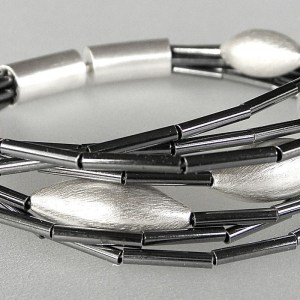 785 - Seven Strand Bracelet With Cones