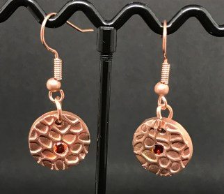 Copper earrings with copper earring hooks and red cubic zirconia stone. £15 + post and packaging.