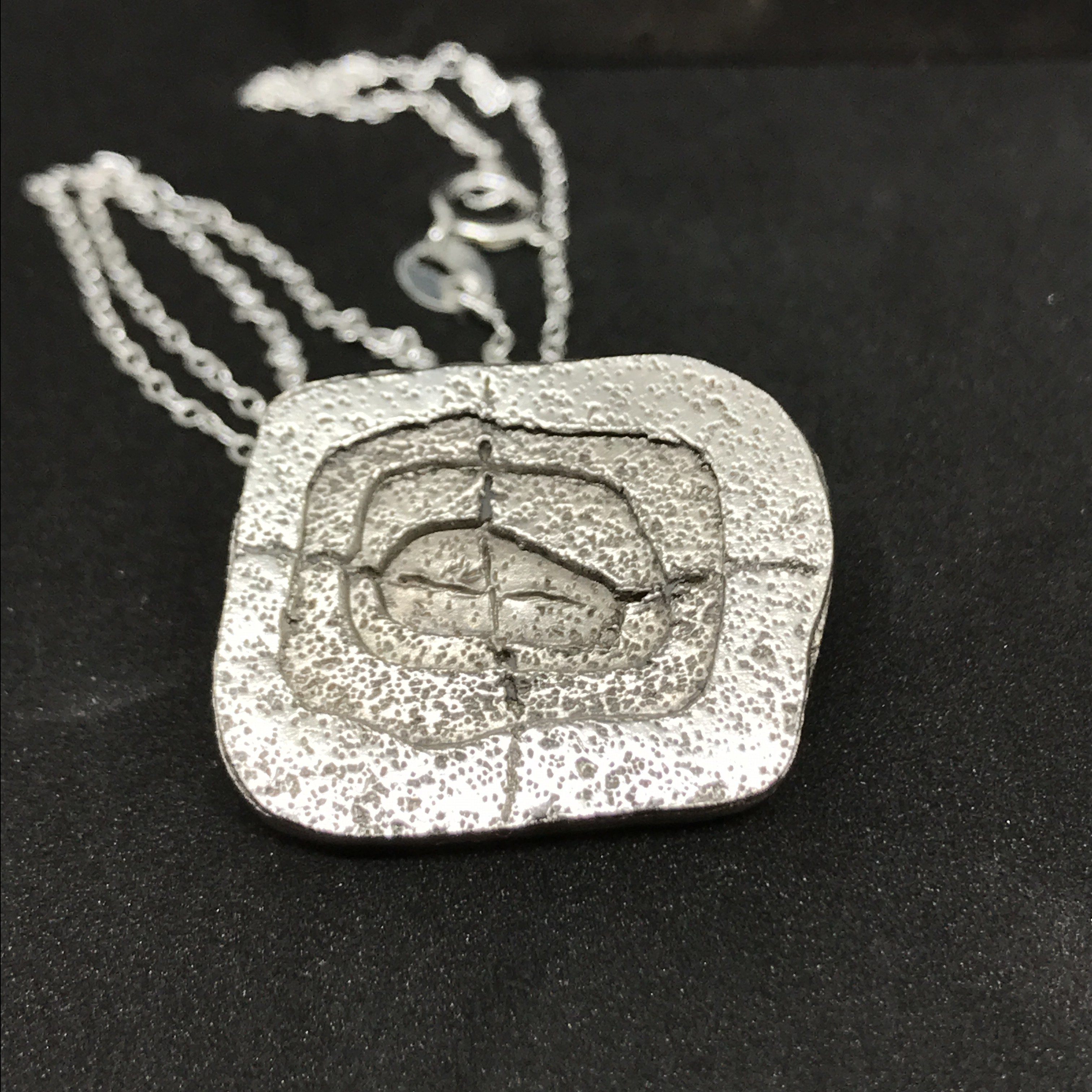 Cracked - Limited Edition. Architectural fine silver pendant with sterling silver chain. £45 +post and packaging. Click here to purchase.