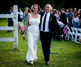 couple with pink bridal bouquet