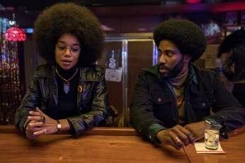 Laura Harrier stars as Patrice and John David Washington as Ron Stallworth in Spike Lee's BlacKkKlansman, a Focus Features release. Credit: David Lee / Focus Features
