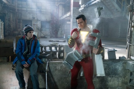 """SHAZAM! Copyright: © 2019 WARNER BROS. ENTERTAINMENT INC. Photo Credit: Steve Wilkie/ & © DC Comics Caption: (L-r) JACK DYLAN GRAZER as Freddy Freeman and ZACHARY LEVI as Shazam in New Line Cinema's action adventure """"SHAZAM!,"""" a Warner Bros. Pictures release."""