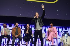 """CHICAGO, IL - APRIL 12: (L-R) John Boyega (Finn), Oscar Isaac (Poe Dameron), Kelly Marie Tran (Rose Tico), Joonas Suotamo (Chewbacca), Naomi Ackie (Jannah) and R2-D2 onstage during """"The Rise of Skywalker"""" panel at the Star Wars Celebration at McCormick Place Convention Center on April 12, 2019 in Chicago, Illinois. (Photo by Daniel Boczarski/Getty Images for Disney ) *** Local Caption *** R2-D2; John Boyega; Oscar Isaac; Kelly Marie Tran; Joonas Suotamo; Naomi Ackie"""