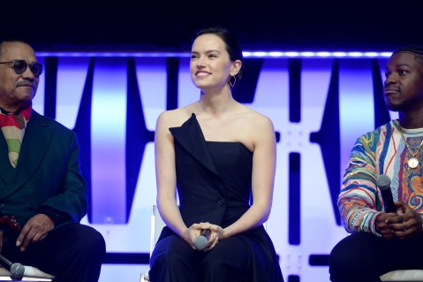 """CHICAGO, IL - APRIL 12: (L-R) Billy Dee Williams (Lando Calrissian), Daisy Ridley (Rey) and John Boyega (Finn) onstage during """"The Rise of Skywalker"""" panel at the Star Wars Celebration at McCormick Place Convention Center on April 12, 2019 in Chicago, Illinois. (Photo by Daniel Boczarski/Getty Images for Disney ) *** Local Caption *** John Boyega; Billy Dee Williams; Daisy Ridley"""