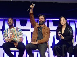 """CHICAGO, IL - APRIL 12: (L-R) John Boyega (Finn), Oscar Isaac (Poe Dameron) and Kelly Marie Tran (Rose Tico) onstage during """"The Rise of Skywalker"""" panel at the Star Wars Celebration at McCormick Place Convention Center on April 12, 2019 in Chicago, Illinois. (Photo by Daniel Boczarski/Getty Images for Disney ) *** Local Caption *** Oscar Isaac; Oscar Isaac; Kelly Marie Tran"""