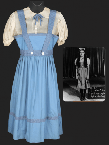 A test pinafore of all-blue with gingham trim and off-white blouse