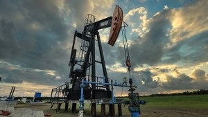 pumpjack in front of clouds
