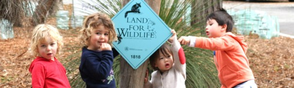 Silver Tree kids with Land for Wildlife sign