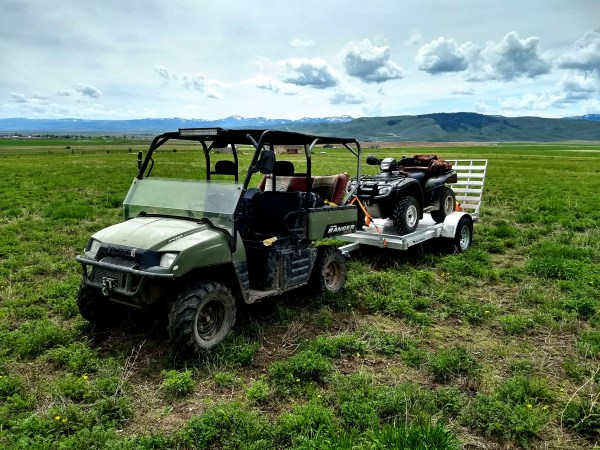 UTV towing the trailer with an ATV on it