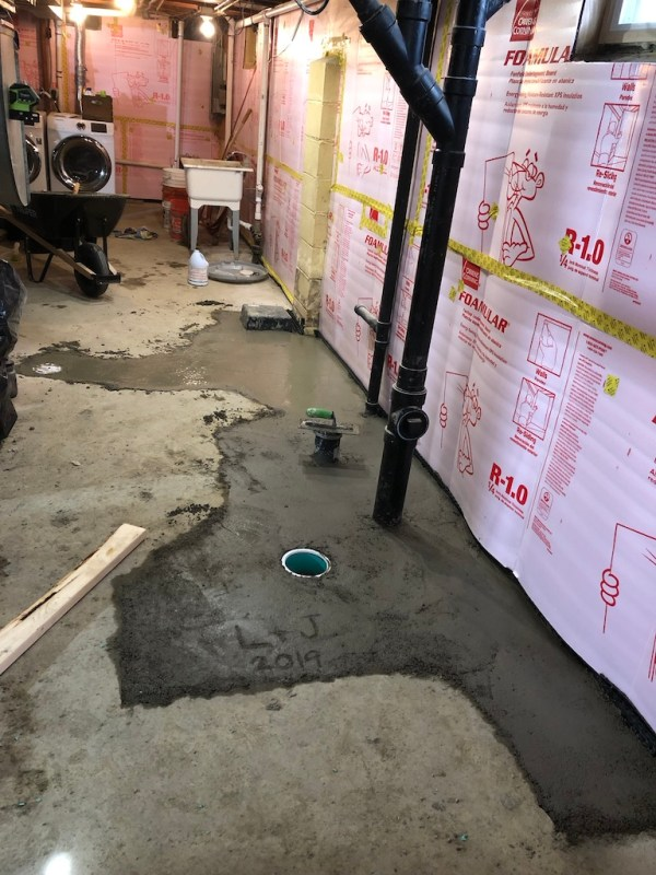 Roughed in plumbing, drain tile, and vapor barrier in basement