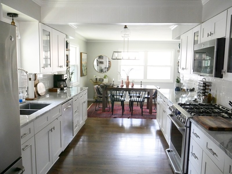 Sima Spaces Kitchen renovation after photos; white kitchen, marble countertops, modern farmhouse kitchen