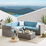 Rattn Outdoor corner sofa with blue cushions