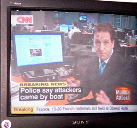 global voices website being shown on CNN, photo of a tv