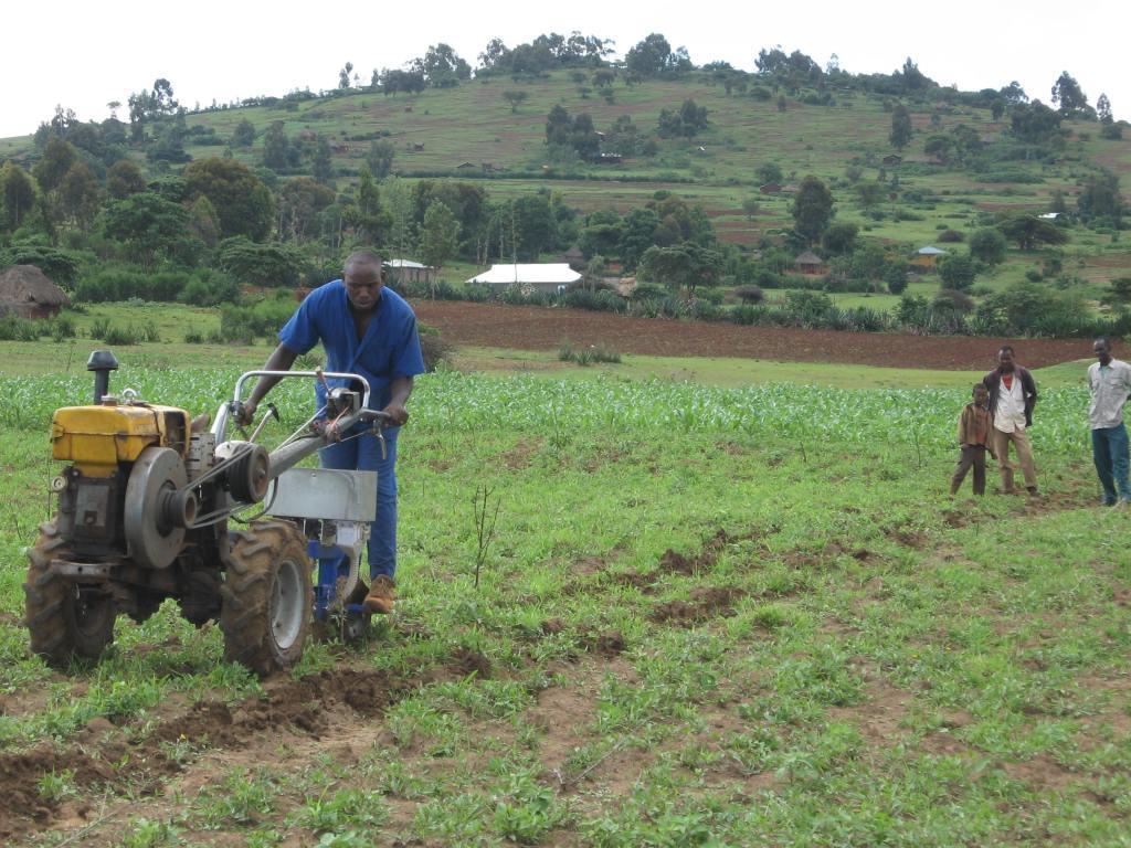Farmer using a two-wheel tractor in Tanzania
