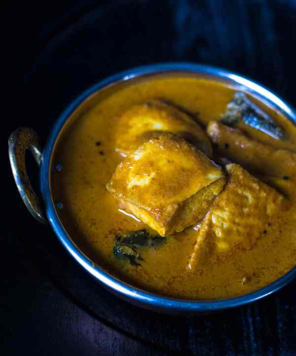 Looking for a fresh new way to cook fish? Try Meen Gassi or Mangalorean fish curry - a spicy and tangy curry that your family will love and is lick-your-fingers good.