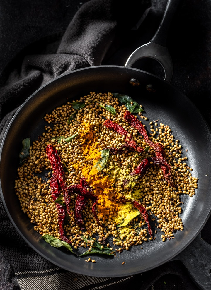 Roasted Rasam ingredients are placed in a pan