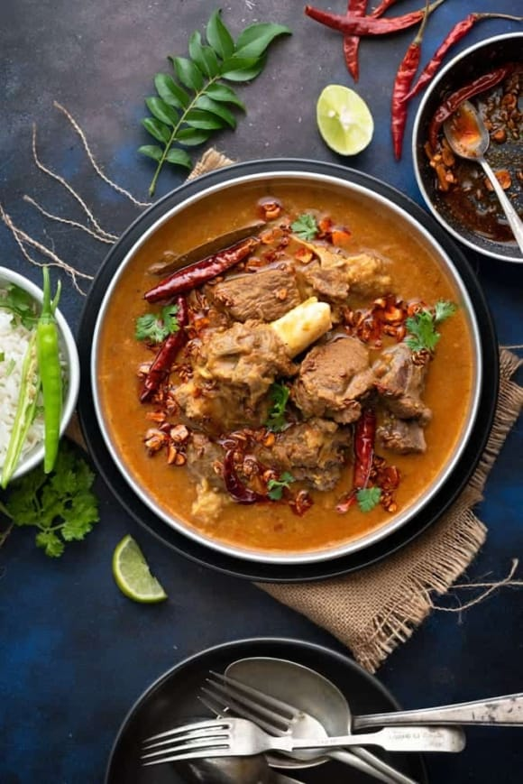 An overhead shot of Dal Gosht served with rice