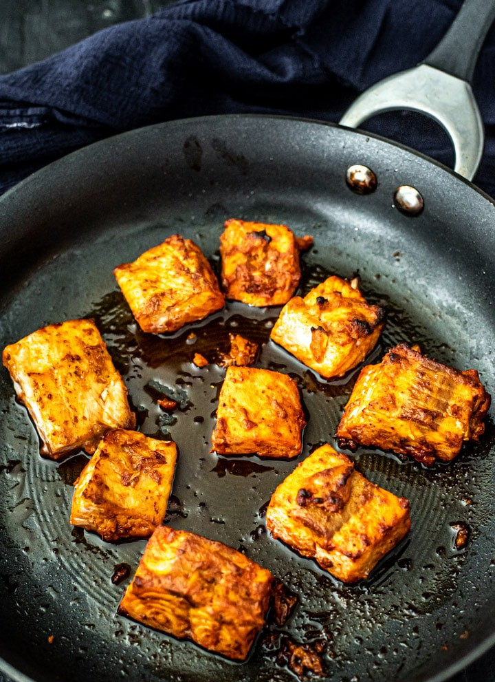Cooked Tandoori Salmon in a non-sitck pan.