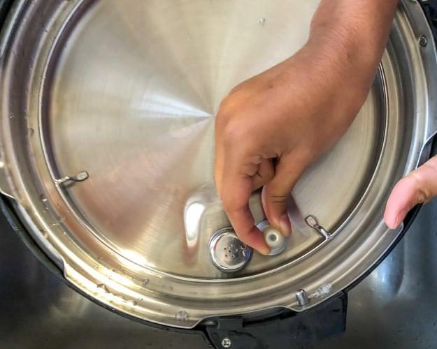 Take off the silicone cap to remove the valve