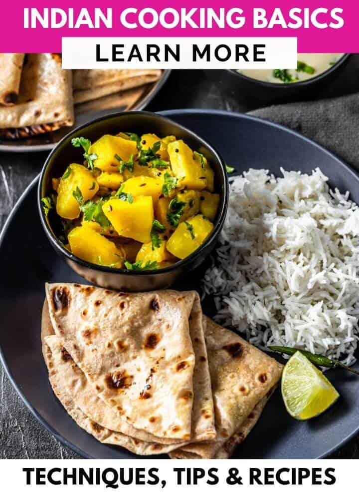 A black plate with rice, lemon wedges and potato side dish. A caption over the image reads Indian cooking basics learn more
