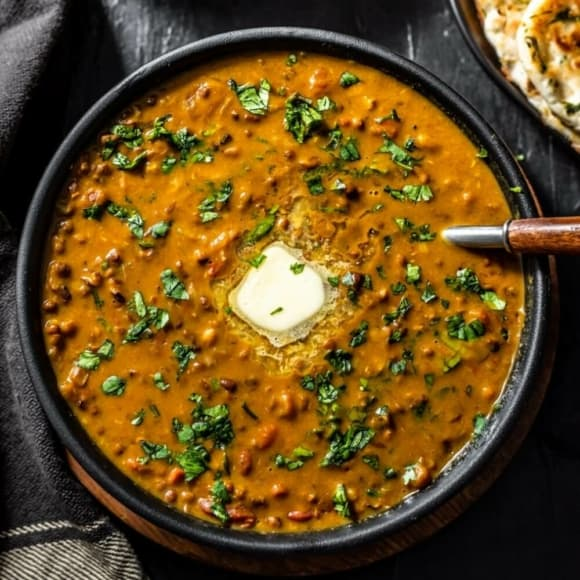 An overhead shot of Dal Makhani in a black bowl