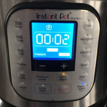 An Instant pot with 2 minutes showing on the panel.