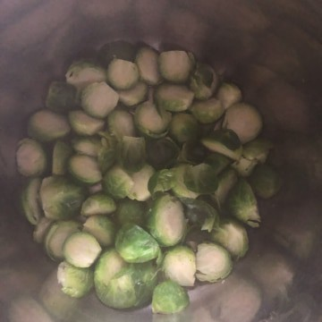 Brussel sprouts in the instant pot after steaming for 2 minutes.