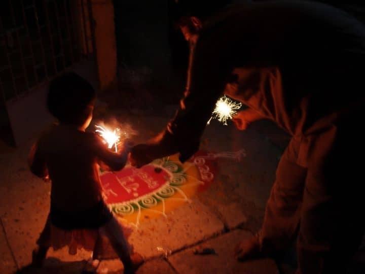 Kids bursting crackers on Diwali