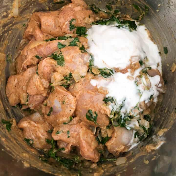 Coconut milk added to chicken methi in the instant pot.