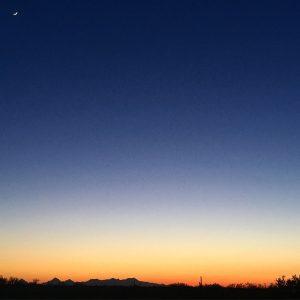 Sonoran desert sunset, with the Tucson Mountains on the horizon.