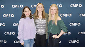 The three stand before the CMF backdrop